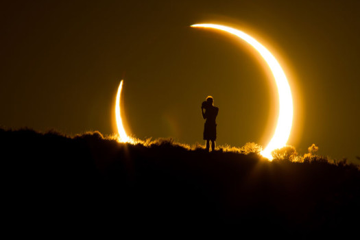 Albuquerque, NM: An Onlooker Witnesses the Annular Solar Eclipse as the Sun Sets on May 20, 2012. Colleen Pinski, Finalist – The Natural World.
